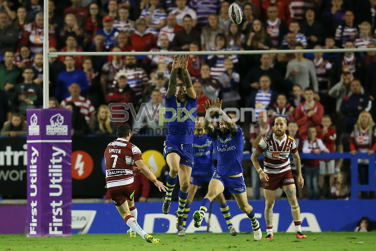 Picture by Paul Currie/SWpix.com - 16/09/2016 - Rugby League - First Utility Super League - Warrington Wolves v Wigan Warriors - Halliwell Jones Stadium, Warrington, England - Wigan Warriors Matty Smith scores a drop goal