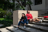 Ella Ezratty '19 and Yolbars Myhre '21 relax from studying for finals on the steps outside the library<br />