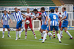 Hartlepool United (in blue shirts) defending during the first-half at the Victoria Ground, Hartlepool, during a pre-season friendly between the home team and Middlesbrough. Hartlepool were relegated to League Two at the end of the 2012-13 season whilst their Teesside neighbours remained two divisions above them in the Championship. The game ended in a no-score draw, the home team's goalkeeper Scott Flinders saving a second-half penalty from Boro's Lucas Jutkiewicz, watched by a crowd of 2307.