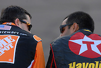 Apr 19, 2007; Avondale, AZ, USA; Nascar Nextel Cup Series drivers Tony Stewart (20) and Juan Pablo Montoya (42) talk on pit road during qualifying for the Subway Fresh Fit 500 at Phoenix International Raceway. Mandatory Credit: Mark J. Rebilas