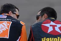 Apr 19, 2007; Avondale, AZ, USA; Nascar Nextel Cup Series drivers Tony Stewart (20) and Juan Pablo Montoya (42) talk on pit road during qualifying for the Subway Fresh Fit 500 at Phoenix International Raceway. Mandatory Credit: Mark J. Rebilas