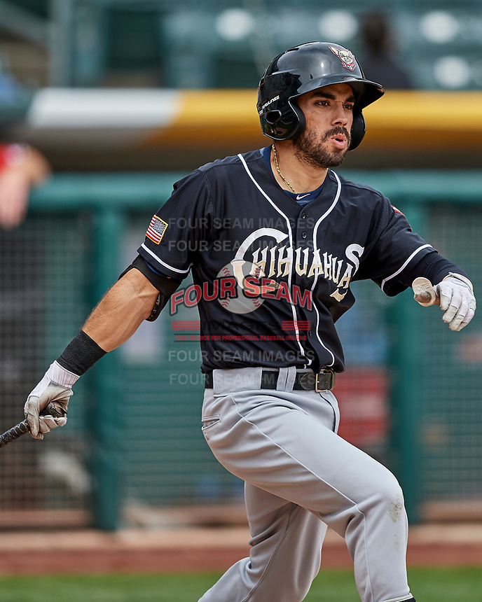 Carlos Asuaje (2) of the El Paso Chihuahuas follows through while batting against the Salt Lake Bees in Pacific Coast League action at Smith's Ballpark on April 30, 2017 in Salt Lake City, Utah. El Paso defeated Salt Lake 3-0. This was Game 1 of a double-header. (Stephen Smith/Four Seam Images)