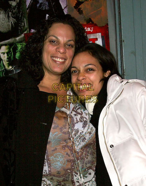 ISABEL DAWSON & ROSARIO DAWSON.'Rent' Cast and Crew Party at Life Cafe.  New York..18th November 2005.Ref: ADM/JL.half length family related with together cuddling hugging white poloneck jumper.www.capitalpictures.com.sales@capitalpictures.com.© Capital Pictures...