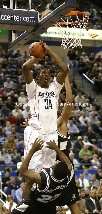 HARTFORD, CT, 01/17/08- 011708BZ07- UConn's Hasheem Thabeet (34) goes to the hoop against Providence's Brian McKenzie (23) during their game at the XL Center in Hartford Thursday night.<br /> Jamison C. Bazinet Republican-American