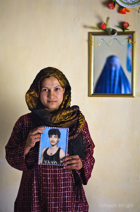 Woman with photo of her dead husband, Bamiyan, Afghanistan 2007