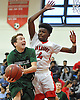 Pat Williamson #30 of Harborfields, left, looks to drive inside the paint as Anthony Benjamin #4 of Amityville guards him during a Suffolk County varsity boys basketball game at Amityville High School on Thursday, Jan. 12, 2017. Harborfields won by a score of 81-41.
