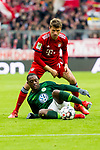 09.03.2019, Allianz Arena, Muenchen, GER, 1.FBL,  FC Bayern Muenchen vs. VfL Wolfsburg, DFL regulations prohibit any use of photographs as image sequences and/or quasi-video, im Bild Thomas M&uuml;ller (FCB #25) im kampf mit Jerome Roussillon (Wolfsburg #15) <br /> <br />  Foto &copy; nordphoto / Straubmeier