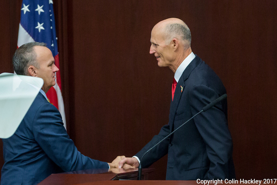 TALLAHASSEE, FLA. 3/7/17-House Speaker Richard Corcoran, R-Land O'Lakes, left, shakes hands with Gov. Rick Scott after his State of the State address as at the Capitol in Tallahassee.<br /> <br /> COLIN HACKLEY PHOTO