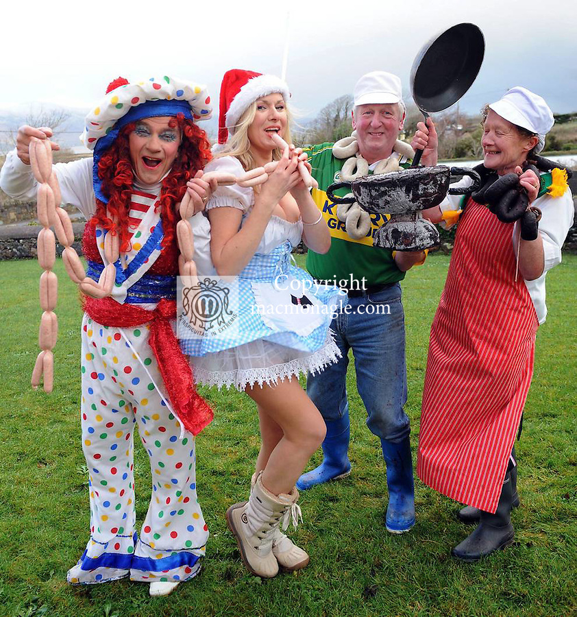 "14-12-11:  Sunday World journalist Geraldine Comiskey with John Paul and Kathleen O'Connor, Sasta Sausages, Cromane, Co. Kerry and ""Sammy Sausages Dame"" Declan Mangan, from the Killorglin Panto Group. Picture: Eamonn Keogh (MacMonagle, Killarney)"