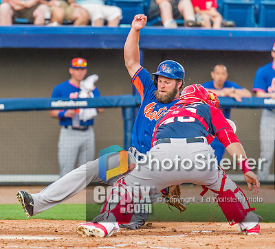 5 March 2015: New York Mets outfielder Kirk Nieuwenhuis slides home safely to score the Mets' 4th run of the game in the third inning of Spring Training action against the Washington Nationals at Space Coast Stadium in Viera, Florida. The Mets fell to the Nationals after a late inning rally, dropping a 5-4 Grapefruit League game. Mandatory Credit: Ed Wolfstein Photo *** RAW (NEF) Image File Available ***