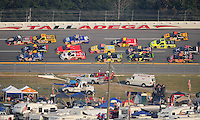Oct 4, 2008; Talladega, AL, USA; NASCAR Craftsman Truck Series driver Kyle Busch (51) Brian Scott (16) and Colin Braun (6) battle three wide for the lead during the Mountain Dew 250 at the Talladega Superspeedway. Mandatory Credit: Mark J. Rebilas-