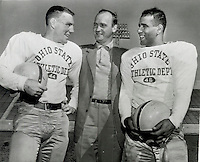 "OSU - Ohio State football - 1954 . "" Les Horvath - OSU All-American of a decade ago, (center) chats with Hop Cassady ( left ) (AKA Hopalong Cassady ), 1954  All-American, and Bobby Watkins, halfback, at Rose Bowl training camp in Pasadena. "" December 21, 1954 . TRAINING FOR THE 1955 ROSE BOWL.  The 1955 rose bowl was played Jan. 1, 1955. (Dispatch file photo)"