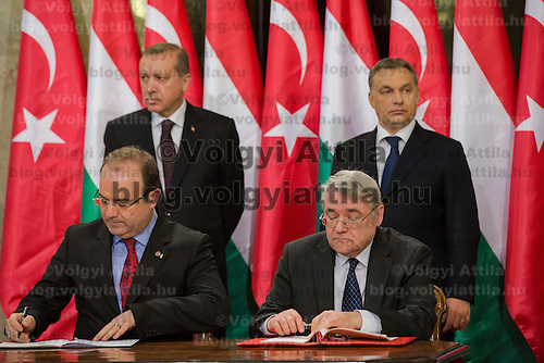 Serdar Cam (front L) president of Turkish Development Agency and Laszlo Baranyay (front R) president of Hungarian Development Bank MFB sign an agreement for protection of Turkish cultural heritage in Hungary. In the background Recep Tayyip Erdogan (L) Prime Minister of Turkey and his counterpart Viktor Orban (R) in Budapest, Hungary on February 05, 2013. ATTILA VOLGYI