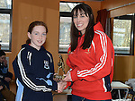 Senior ladies player Michaela O'Boyle presents under 12 girls player of the year Eva Cummins with her trophy at the Newtown Blues juvenile awards presentations held in the Barbican Centre. Photo:Colin Bell/pressphotos.ie