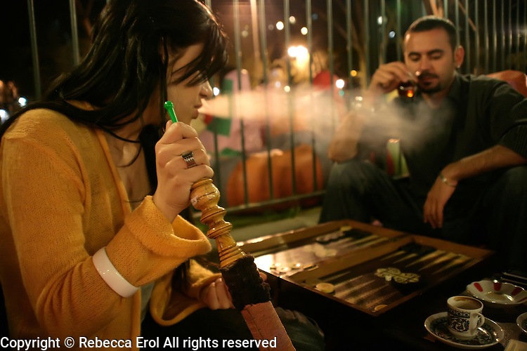 Smoking nargile (hookah) and playing tavla (backgammon) at one of the Tophane nargile cafes in Istanbul, Turkey