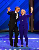 United States President Barack Obama and former US Secretary of State Hillary Clinton after he completed his remarks during the third session of the 2016 Democratic National Convention at the Wells Fargo Center in Philadelphia, Pennsylvania on Wednesday, July 27, 2016.<br /> Credit: Ron Sachs / CNP<br /> (RESTRICTION: NO New York or New Jersey Newspapers or newspapers within a 75 mile radius of New York City)
