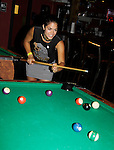 Kelly Thiebaud shoots pool at 15th Southwest Florida Soapfest 2014 Charity Weekend with a Bartending/Karaoke get together on May 26, 2104 at Porky's, Marco Island, Florida. (Photo by Sue Coflin/Max Photos)