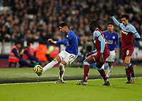 28th December 2019; London Stadium, London, England; English Premier League Football, West Ham United versus Leicester City; Ayoze Perez of Leicester City clearing the ball out past Arthur Masuaku of West Ham United - Strictly Editorial Use Only. No use with unauthorized audio, video, data, fixture lists, club/league logos or 'live' services. Online in-match use limited to 120 images, no video emulation. No use in betting, games or single club/league/player publications