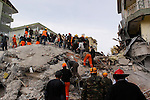 ERCIS, TURKEY: Rescue workers search for earthquake survivors...On October 23, 2011, a 7.2 magnitude earthquake hit eastern Turkey killing over 250 people and wounding over a thousand...Photo by Ali Arkady/Metrography