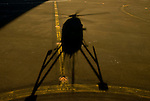 Shadow of a helicopter taking off