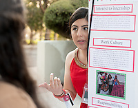 Occidental College student Saaron Ramirez '17 shares her InternLA experience working at the Office of the Consulate General of Mexico in Los Angeles during the Career Development Center's Reverse Career Fair, Thorne Hall patio, Sept. 3, 2015.<br /> (Photo by Marc Campos, Occidental College Photographer)