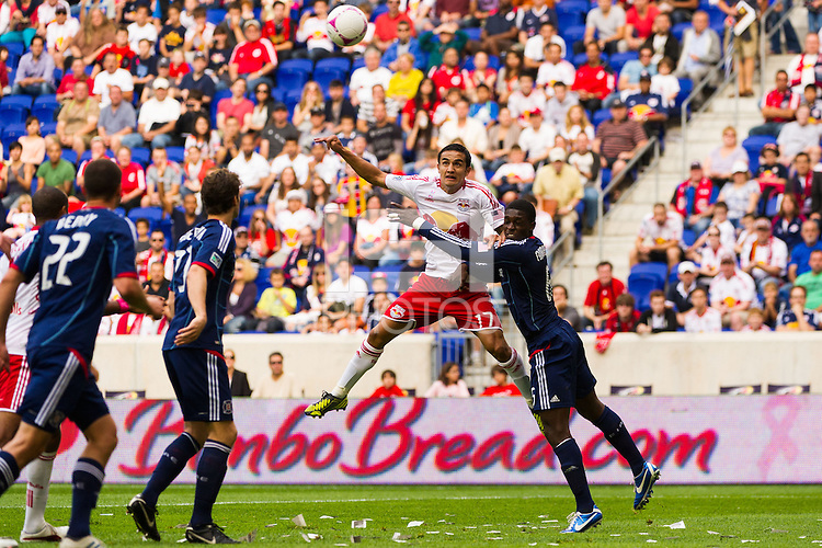 Tim Cahill (17) of the New York Red Bulls and Jalil Anibaba (6) of the Chicago Fire go up for s header during a Major League Soccer (MLS) match at Red Bull Arena in Harrison, NJ, on October 06, 2012.