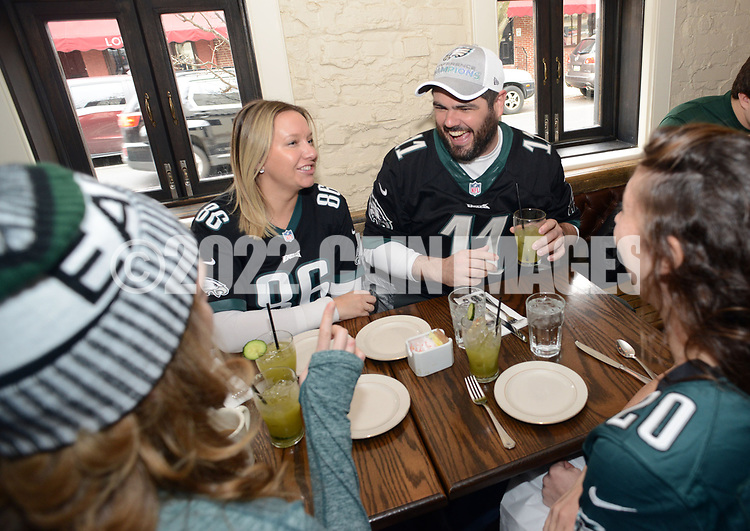 CAPTION CORRECTION: CORRECTS BROPHY: From left, Philadelphia Eagles fans Sara Goto of Rochester, New York, Sarah Quigley #86 of Haverford, Pennsylvania, Matt Brophy #11 of Philadelphia, and Drew Paolucci #20 of Philadelphia enjoy brunch at Pub & Kitchen Sunday, February 04, 2018 in Philadelphia, Pennsylvania. The pub added Bleeding Green Bloody Marys and Crispy Fried Brady Chicken to the menu. WILLIAM THOMAS CAIN / For The Inquirer