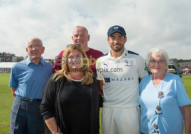 Picture by Allan McKenzie/SWpix.com - 23/08/2016 - Cricket - Specsavers County Championship - Yorkshire County Cricket Club v Nottinghamshire County Cricket Club - North Marine Road, Scarborough, England - Jack Leaning with his family after being presented with his Yorkshire county cap.