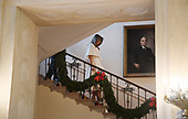 First Lady Melania Trump walks down the Grand Staircase from the Residence as she participates in arts and crafts projects with children and students from Joint Base Andrews in various rooms throughout the White House in Washington, DC, November 27, 2017.<br /> Credit: Olivier Douliery / Pool via CNP
