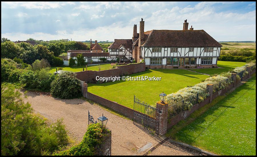 BNPS.co.uk (01202 558833)<br /> Pic: Strutt&Parker/BNPS<br /> <br /> Tudor flat packed home just a short sand wedge from the beach AND the golf course.<br /> <br /> This stunning beachside property comes with sea views as far as Europe and a top golf course on the doorstep.<br /> <br /> Kentlands is a Grade II listed Arts & Crafts home on the private Sandwich Bay estate in Kent with direct access to a beautiful, quiet beach.<br /> <br /> The house is also right next door to the world famous Royal St George's Golf Club, one of the few courses where the British Open is held, and is expected to appeal to professional players.<br /> <br /> But you'll need a decent wedge to buy it - the property is on the market with Strutt & Parker for £3.3million.