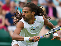 26-06-13, England, London,  AELTC, Wimbledon, Tennis, Wimbledon 2013, Day three, Dustin Brown (GER)<br /> <br /> <br /> <br /> Photo: Henk Koster