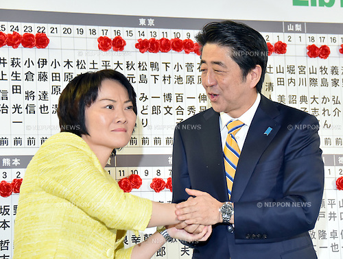 December 14, 2014, Tokyo, Japan - Victorious Prime Minister Shinzo Abe congratulates Miki Yamada on her winning a seat at the headquarters of the ruling Liberal Democratic Party in Tokyo as early returns from Sunday's general election indicate a landslide victory by the LDP on December 14, 2014. The LDP will leky to secure a majority as voters gave Abe a fresh mandate to forge ahead with his economic policy. (Photo by Natsuki Sakai/AFLO) AYF -mis-