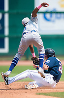 NWA Democrat-Gazette/CHARLIE KAIJO Tulsa Drillers shortstop Errol Robinson (6) tags out Northwest Arkansas Naturals left fielder Brandon Downes (26) during a baseball game, Sunday, May 13, 2018 at Arvest Ballpark in Springdale.