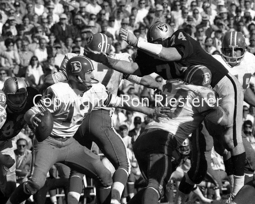 Oakland Raiders vs Kansas City Chiefs...#74 Tom Keating puts rush on KC quarterback. (photo/Ron Riesterer)