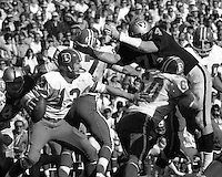 Oakland Raiders vs Kansas City Chiefs...#74 Tom Keating puts rush on KC quarterback. (photo/Ron Riesterer)