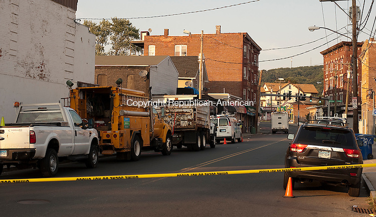 WATERBURY, CT--- -081715JS01- Workers from Eversource Energy look for the cause of a possible underground explosion Monday afternoon on North Main Street in Waterbury. The road was closed and traffic detoured as they investigated. <br /> Jim Shannon Republican-American