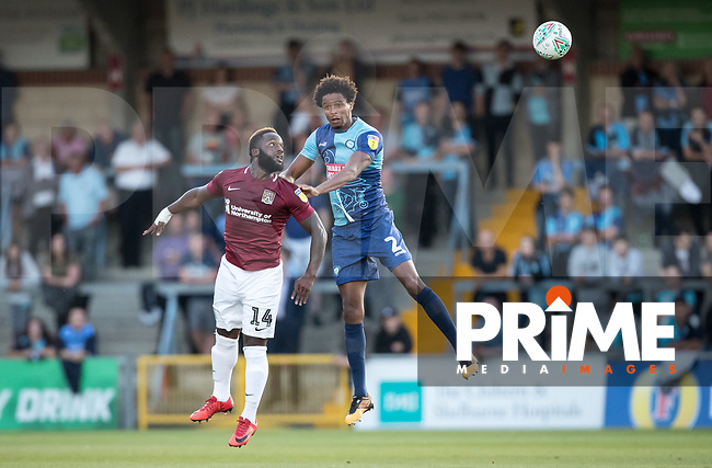 Junior Morias of Northampton Town & Sido Jombati of Wycombe Wanderers during the Carabao Cup match between Wycombe Wanderers and Northampton Town at Adams Park, High Wycombe, England on 14 August 2018. Photo by Andy Rowland.