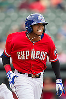 Round Rock Express outfielder Engel Beltre #7 runs to first base against the Omaha Storm Chasers in the Pacific Coast League baseball game on April 7, 2013 at the Dell Diamond in Round Rock, Texas. Omaha beat Round Rock 5-2, handing the Express their first loss of the season. (Andrew Woolley/Four Seam Images).
