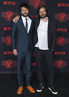 """WESTWOOD - OCTOBER 26:  Ross Duffer and Matt Duffer at the premiere of Netflix's """"Stranger Things"""" Season 2 at the Regency Village Theatre on October 26, 2017 in Westwood, California. (Photo by Scott Kirkland/PictureGroup)"""