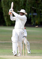 Adrian Green of Wembley is clean bowled by John Scantlebury during the Middlesex County League Division Three game between North London and Wembley at Park Road, Crouch End on Sat July 24, 2010