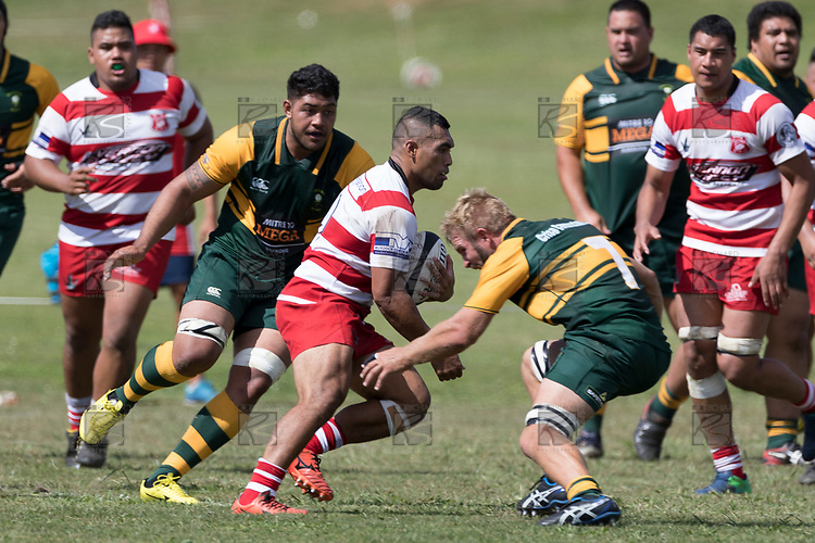 Desma Liaina heads upfield towards William Bond. Counties Manukau Premier Counties Power Club Rugby game between Karaka and Pukekohe, played at the Karaka Sports Park on Saturday March 10th 2018. Pukekohe won the game 31 - 27 after trailing 5 - 20 at halftime.<br /> Photo by Richard Spranger.