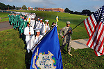 Michelle Mullen and Jeremy Chevalier, who is a member of the Army National Guard, lead the procession from the school to athletic field where their family and friends wait for their arrival, during the Enfield High School graduation ceremony,  Saturday, June 24, 2011, at Enfield High School. (Jim Michaud/Journal Inquirer)