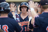 Tanner Morris (10) of the Virginia Cavaliers is greeted by his teammates after scoring a run against the Wake Forest Demon Deacons at David F. Couch Ballpark on May 19, 2018 in  Winston-Salem, North Carolina.  The Demon Deacons defeated the Cavaliers 18-12.  (Brian Westerholt/Four Seam Images)