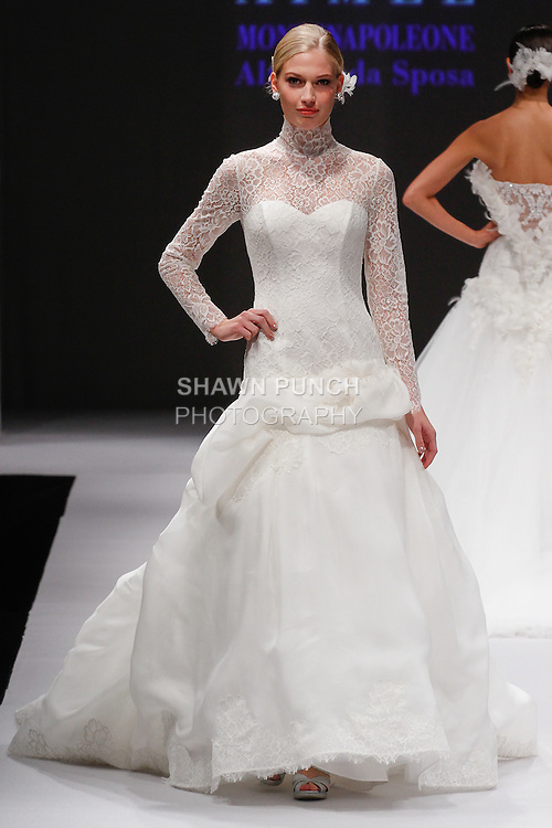 Model walks runway in a bridal gown from the Atelier Aimee collection by Lucia Zanotti, during the Designer Spotlight Spring 2014 fashion show at New York International Bridal Week on October 13, 2013.