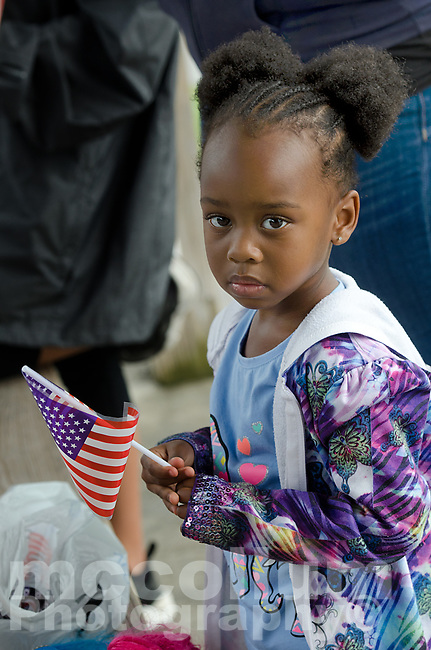 """Michael McCollum<br /> 8/2/18<br /> A young attendee at the reveal ceremony where it was announced to 13 year old Ryan Overman of west Knoxville that The Wish Connection is granting Ryan's wish to go to Washington DC and visit the White House at Carl Cowan Park, 10058 S Northshore Dr, Knoxville, TN, Thursday, August 2, 2018 at 5:45pm. Approximately 50-60 people attended, including the Overman family, friends, and AT&T Employees. The Bearden High School Cadets also attended and lead the pledge of allegiance.<br /> The AT&T Wish Connection is going to send Ryan, his family, and his service dog to Washington DC and while they are gone, the group of volunteers will be doing a makeover on his bedroom and turn it into the """"Oval Office"""" at the White House.<br /> Ryan was born two weeks prematurely on May 13, 2005. During the pregnancy he was classified as high risk due to a measured lack of growth and, after a brief stay in the hospital, he came home weighing only 4 lbs 5 oz. His development was much slower compared to his peers, such as not learning to walk until he was well over a year old, and he was much smaller. The Overman family worked with Tennessee Early Intervention Services (TEIS) when Ryan was about one year old and with their help they were able to get Ryan enrolled through TEIS to receive Occupational, Physical, and Speech Therapy. When Ryan turned three he transitioned from TEIS to the Knox County Early Intervention Program and began attending a special school to continue his therapies until he was old enough to enroll at Cedar Bluff Elementary and now is at Cedar Bluff Middle School. In 2016, Ryan was diagnosed to have retinitis pigmentosa, a degenerative disease of the retinas that under the best of circumstances causes severe tunnel vision, but more commonly results in complete blindness.<br /> Despite the physical difficulties that Ryan has had to endure over the last thirteen years, he continually brightens the lives of those around him. If someone is h"""