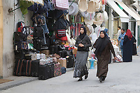 Tripoli, Libya - Street Scene in the Medina (Old City).  Luggage, Wedding Gift Baskets, Libyan Women.
