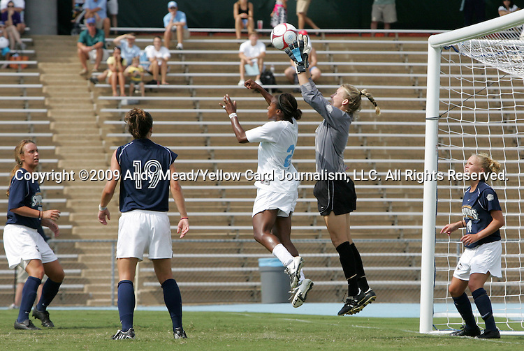 30 August 2009: Greensboro's Kelsey Kearney (in gray) grabs the ball under pressure from North Carolina's Nikki Washington (in white). The University of North Carolina Tar Heels defeated the University of North Carolina Greensboro Spartans 1-0 at Fetzer Field in Chapel Hill, North Carolina in an NCAA Division I Women's college soccer game.