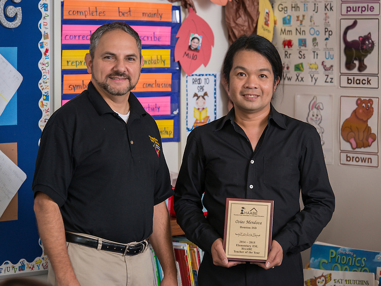 Osias Mendoza, right, poses for a photograph with Robert Chavarria, left, at Love Elementary School, May 20, 2015.