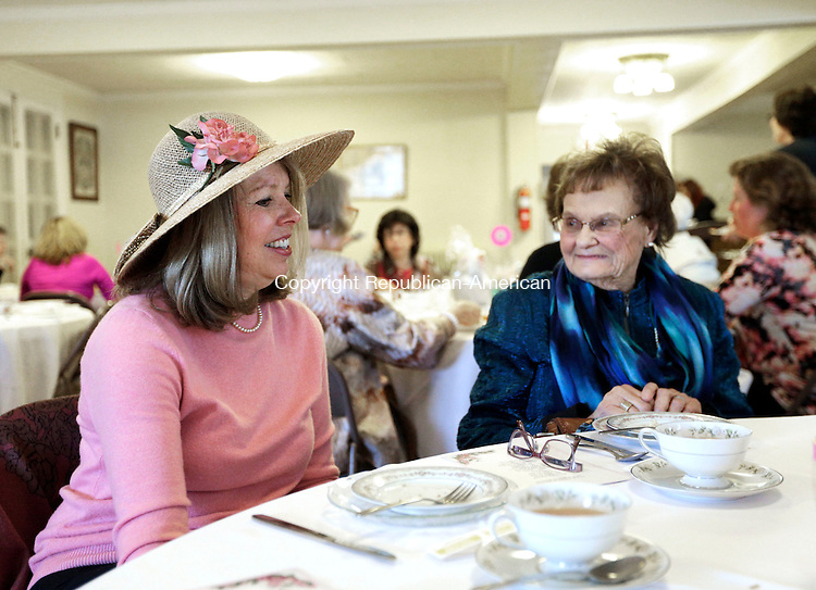 Winsted, CT- 09 April 2016-040916CM08- Kristine Murdick-Coles, left, of New Hartford and her mother Lorraine Murdick of Harwinton chat over tea during the Brooks-Green Woods Chapter of the Daughters of the American Revolution Spring Tea Social fundraiser at St. Andrew's Masonic Lodge in Winsted on Saturday. The event featured tea, finger sandwiches, scones and pastries. Featured speaker Roxanne Lovell from the Aerie Mountain Garden Shop also attended and talked about Victorian and Colonial Gardening.      Christopher Massa Republican-American