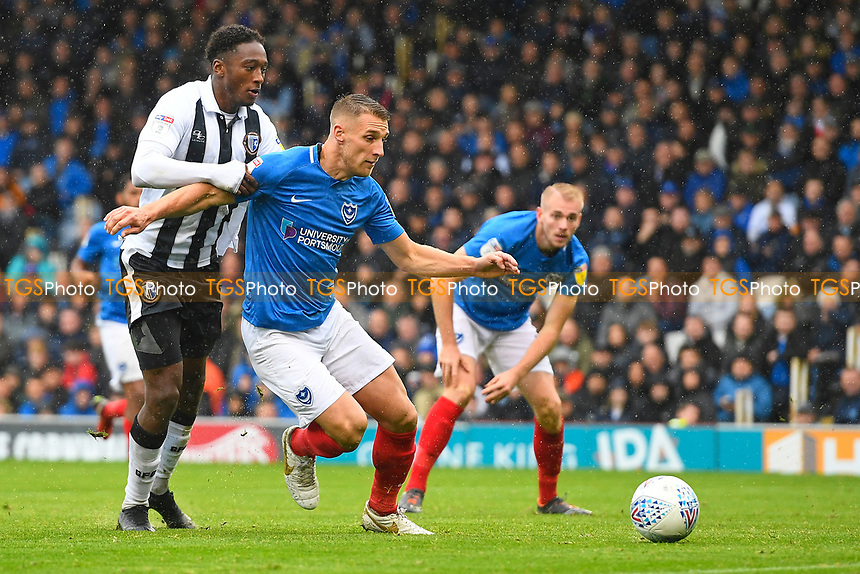 Lee Brown of Portsmouth holds off Brandon Hanlan of Gillingham during Portsmouth vs Gillingham, Sky Bet EFL League 1 Football at Fratton Park on 6th October 2018